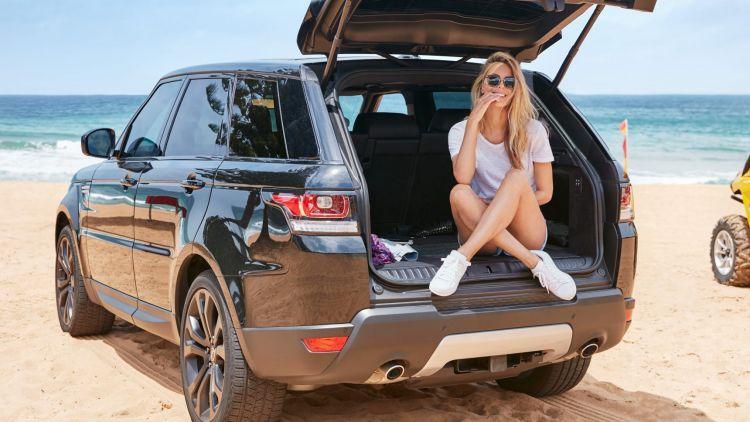 Jennifer Hawkins and a Range Rover Sport.