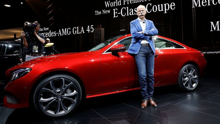 Dieter Zetsche, Chairman of the Board of Directors of Daimler AG and Head of Mercedes-Benz Cars, poses with the new 2018 Mercedes-Benz E-Class Coup.