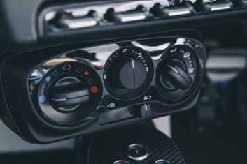 Airconditioning is standard but the switch gear is borrowed from cheaper models.