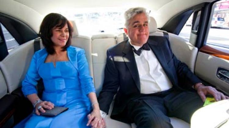Jay Leno and his wife in the Rolls-Royce Ghost.