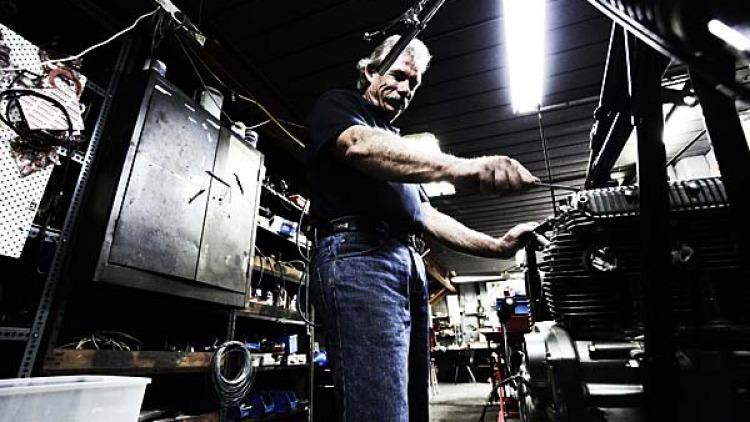 Chris Ray works on an original Triumph Rocket.