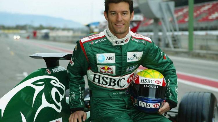 Mark Webber sitting on his Jaguar car formula one motor racing