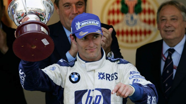 MONTE CARLO, MONACO - MAY 22:  Mark Webber of Australia and BMW Williams celebrates finishing third with the trophy in the Monaco F1 Grand Prix May 22, 2005, in Monte Carlo, Monaco.  (Photo by Getty Images)
