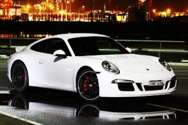 It's been on sale for more than a year, but this is our first chance to drive a 911 Carrera S with a manual gearbox and the eye-catching Sport Design exterior package, which includes the iconic ducktail rear spoiler.