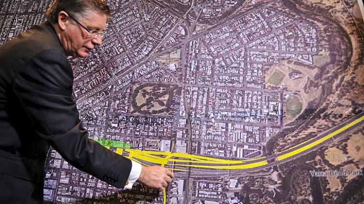 Premier Denis Napthine takes a closer look at the east-west link design.