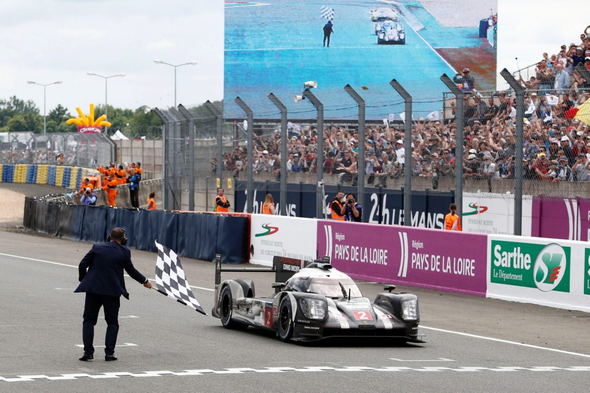 The Porsche 919 Hybrid driven by Neel Jani, Romain Dumas and Marc Lieb claim victory at the 84th 24-hour Le Mans endurance race.