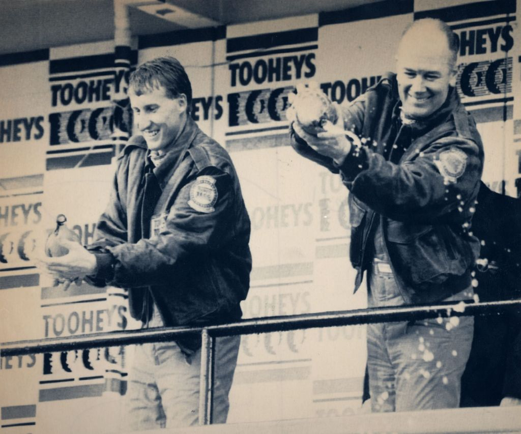 Told 'em: Jim Richards (right) and Mark Skaife (left) gave the fans a spray of champagne but only after Richards gave them a verbal spray.