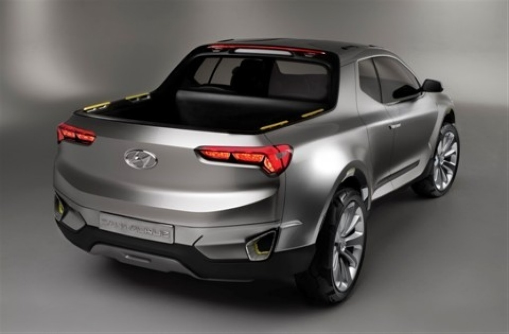 Despite its swoopy profile, the Santa Cruz features seating for five, tie down points and a large tray.