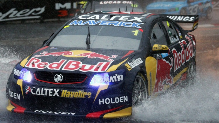 Monsoon madness: Jamie Whincup drives his Red Bull Racing Holden in horrendous conditions in Sydney.