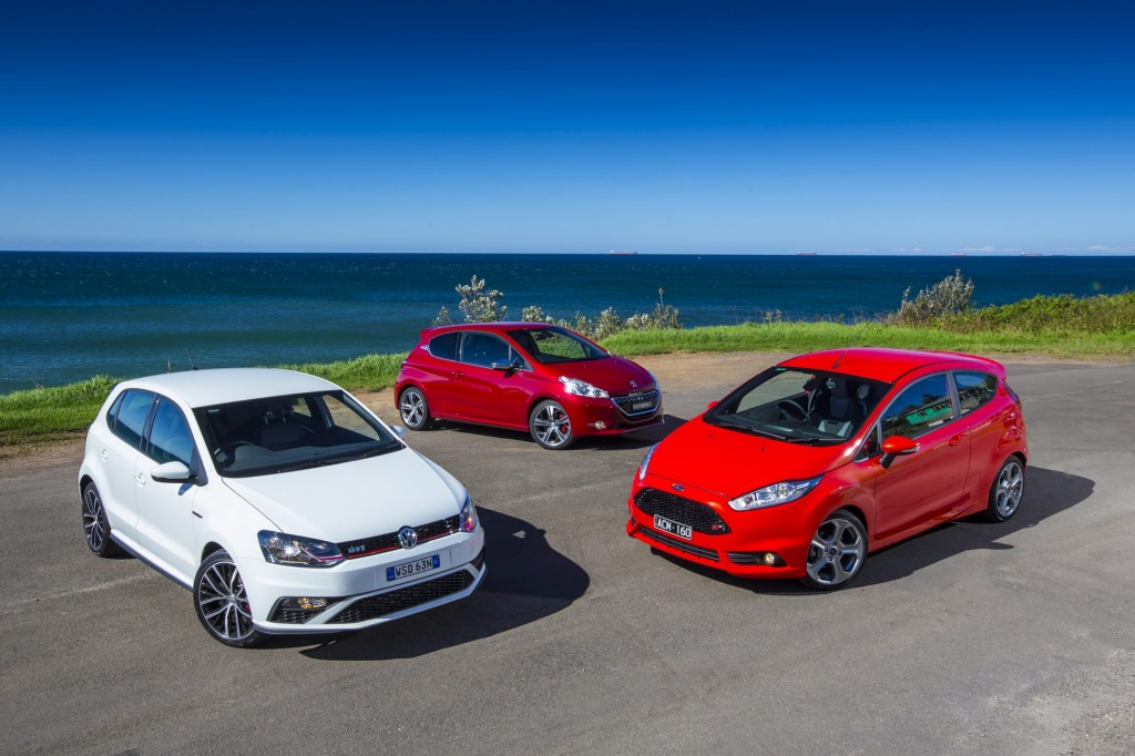 Small stoush: The Volkswagen Polo GTI, left, the Peugeot 208 GTi and the Ford Fiesta ST.