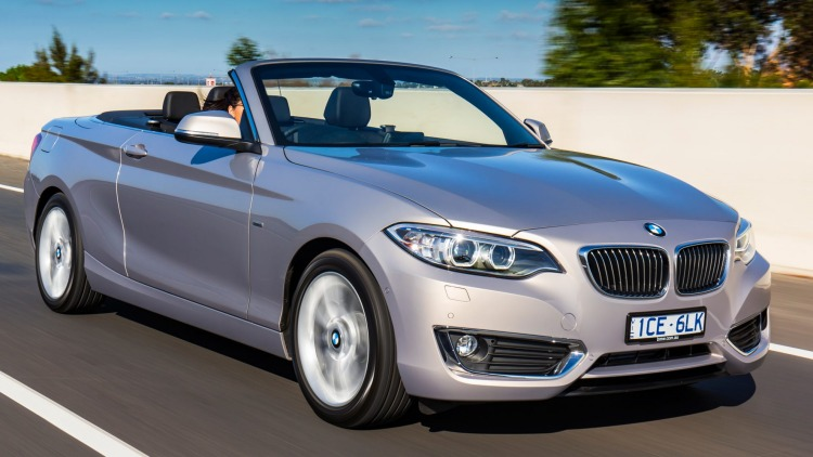 BMW's new 220i convertible hits the road.