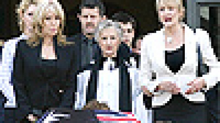 Former de facto wife Bev Brock (R) and Brock's current partner Julie Bamford (L) follow the coffin of legendary Australian motor racing driver, Peter Brock, as it is carried by family members upon leaving St Paul's Catheral in Melbourne. Picture: AFP/Will