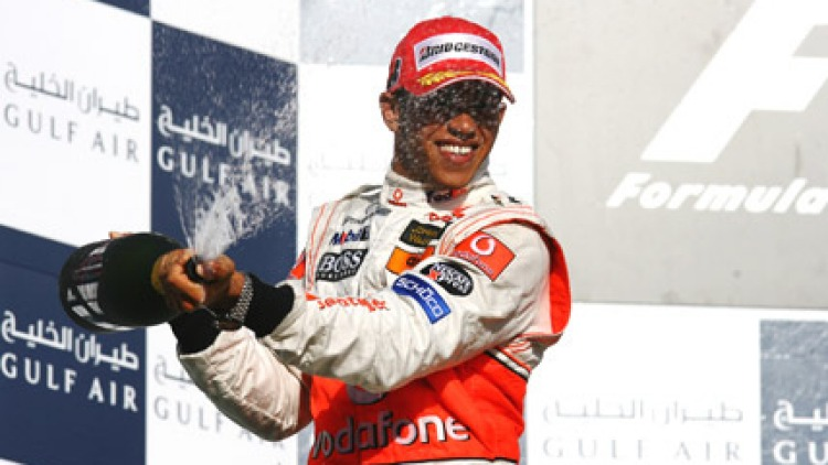 Lewis Hamilton of Great Britain and McLaren Mercedes celebrates his second place finish on the podium following the Bahrain Formula One Grand Prix, April 15, 2007. Picture: Getty Images