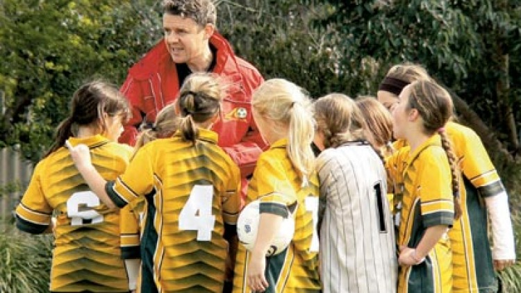 Coach Sauter explains game tactics to his young charges. Picture: Connie Sauter