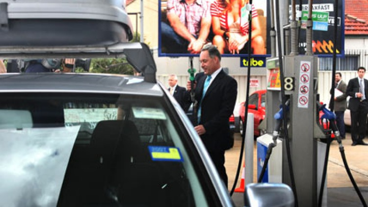 Parish pump politics ... Mr Iemma prepares to fill a car with petrol before his ethanol announcement yesterday. Photo: Kate Geraghty