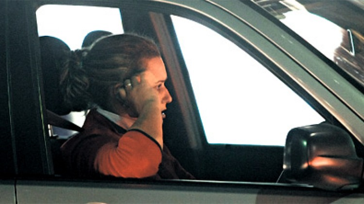 """""""They are safe as long as they aren't talking"""" ... research has found women drivers are more likely to be distracted while on the phone. Photo: James Brickwood"""