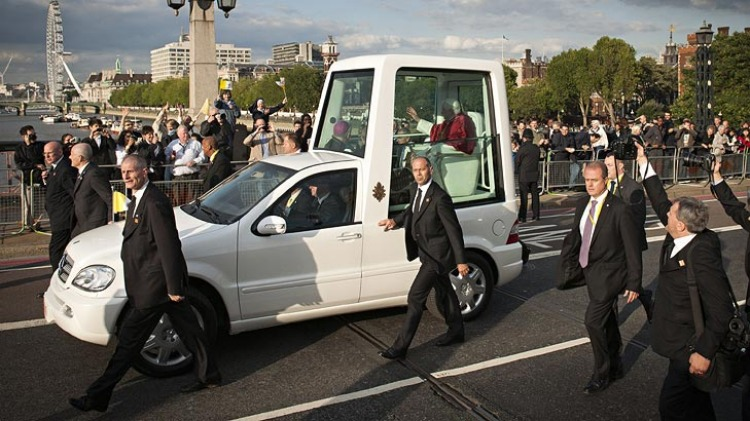 Pope Benedict XVI travels in the popemobile across Lambeth Bridge on his way to the Houses of Parliament in London.