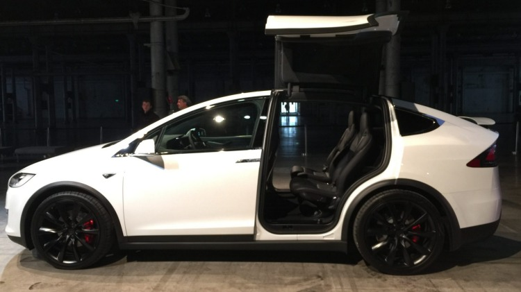 """The electric SUV's """"falcon wing"""" doors represent a unique touch."""