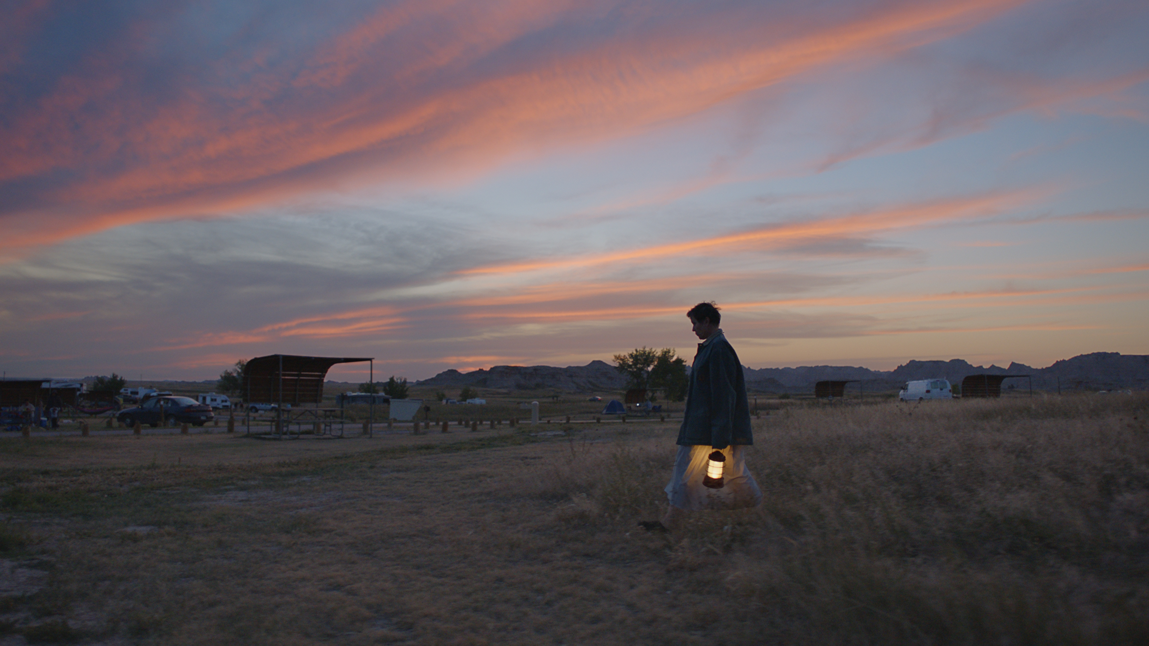 Frances Mcdormand walking with a lantern in her hand