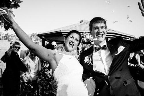 Joyful just married couple by Brisbane wedding photographer