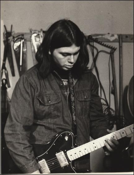 Mark-playing-guitar-in-garage