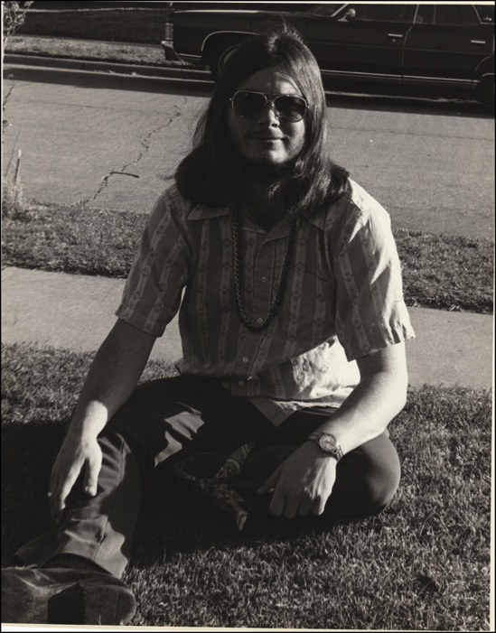 Mark-sitting-in-grass