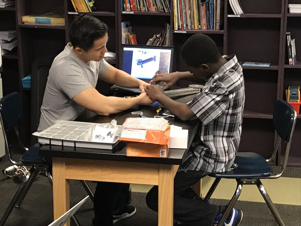Alex pairs with a student from DRW College Prep's robotics team