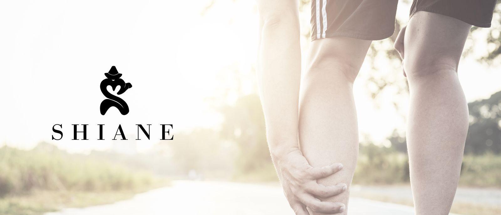 Runner grabbing leg
