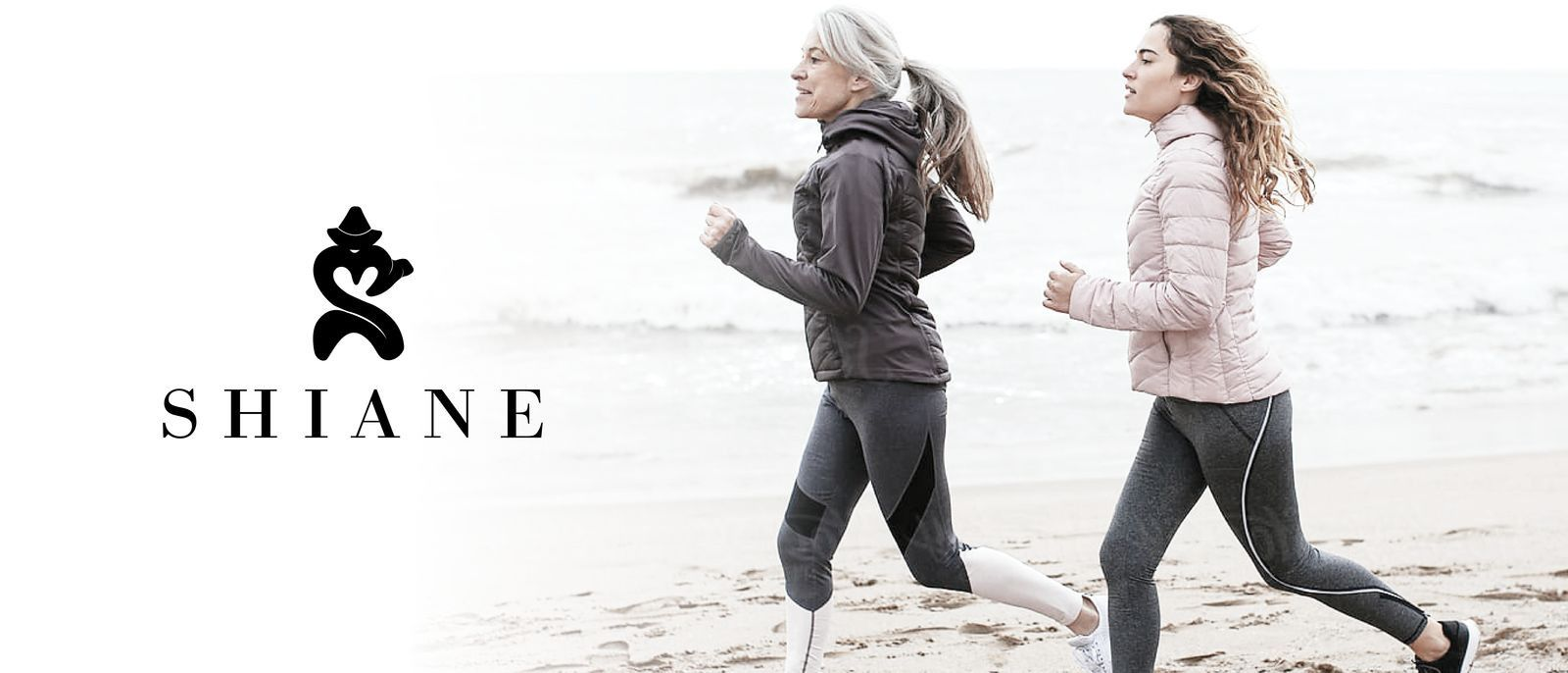 Two woman jogging on the beach