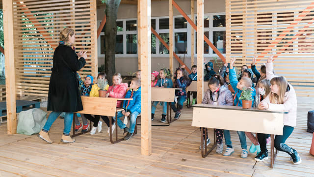 An eco-classroom with rainwater collection system, solar panels, organic garden and compost - creating a space for inspiring education and stimulating eco-consciousness