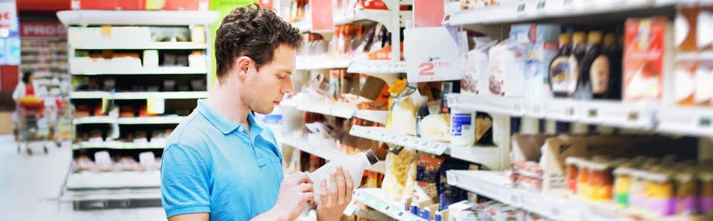 young-man-in-supermarket-reading-label-1500.jpg