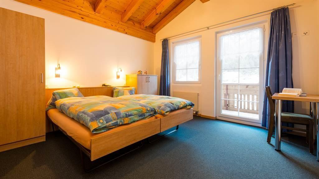 Schlafzimmer Dachgeschoss mit Balkon