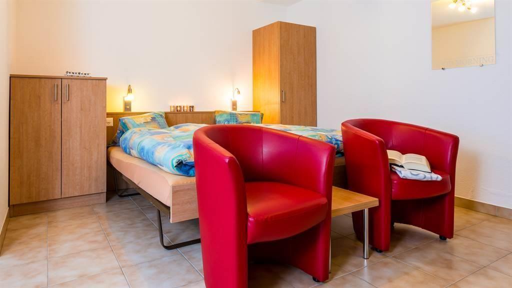Doppelbett mit Sitzplatz