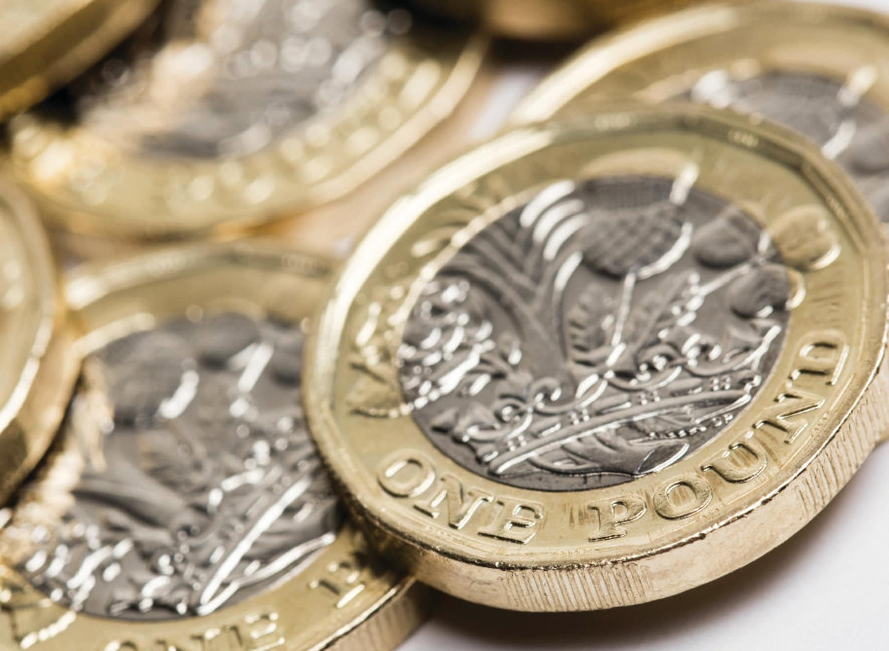 Close up of a pile of British sterling one pound coins