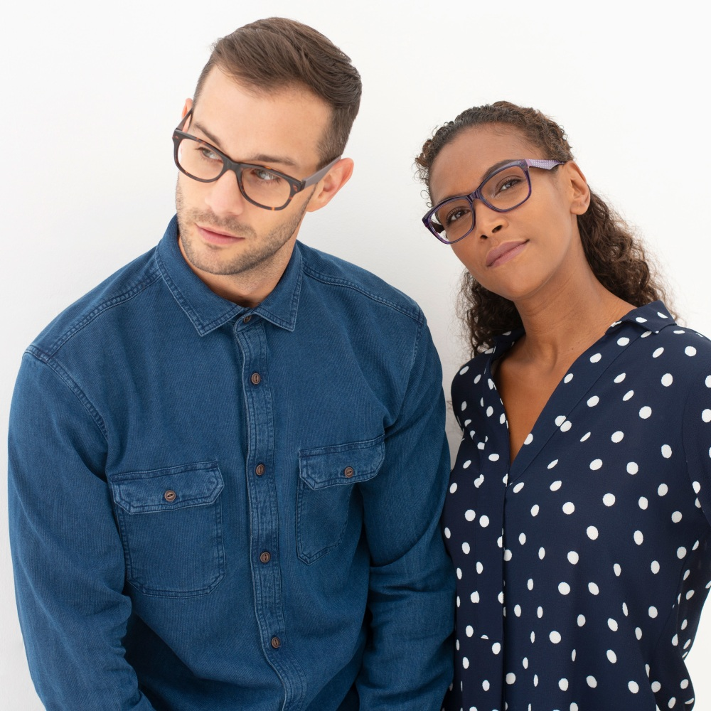 Young couple wearing the latest iChoose glasses