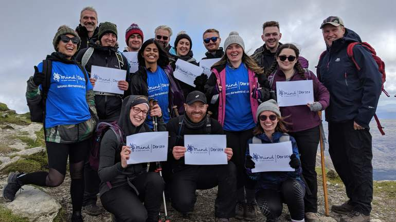 Our trekkers at the summit with Dorset Mind signs and t-shirts