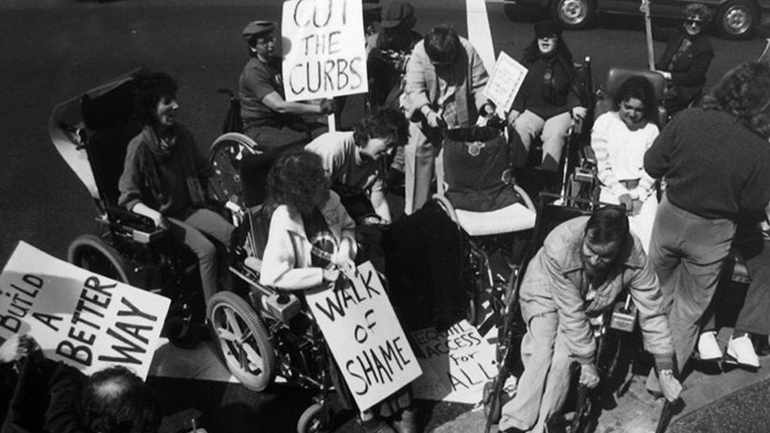 Curb cut protesters smash the curb