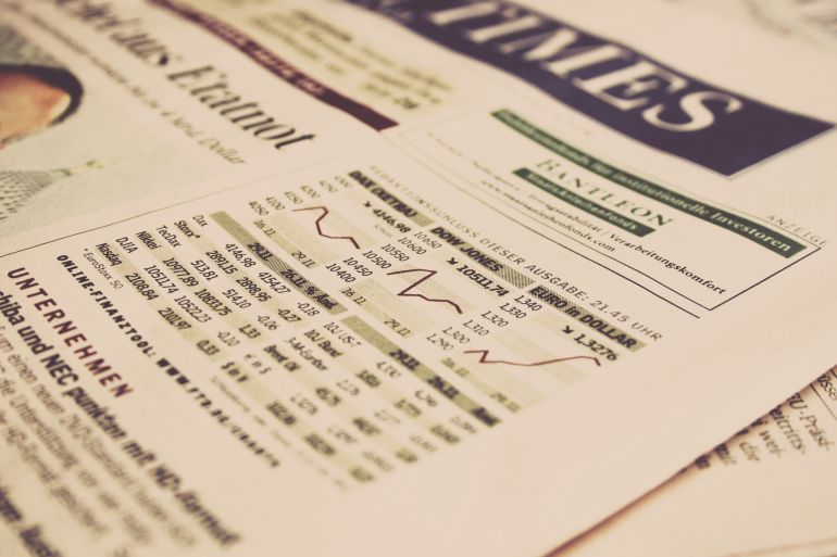 Close-up of a newspaper showing stock market performance
