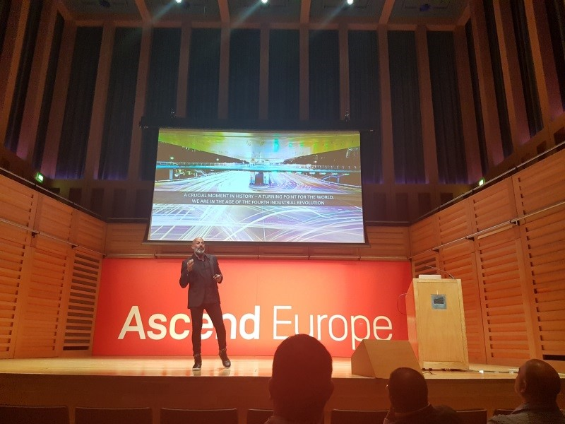 Man on stage at the Ascend Europe conference