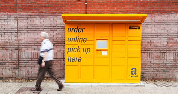 Image of a man walking past an Amazon parcel pick-up locker
