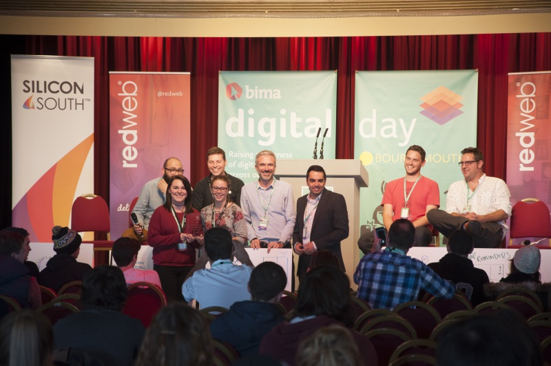 A photo of Andrew Henning on stage with other people at Digital Day
