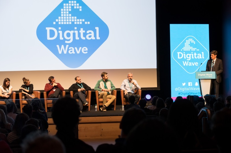 A photo from Digital Wave of Andrew Henning and others talking on stage
