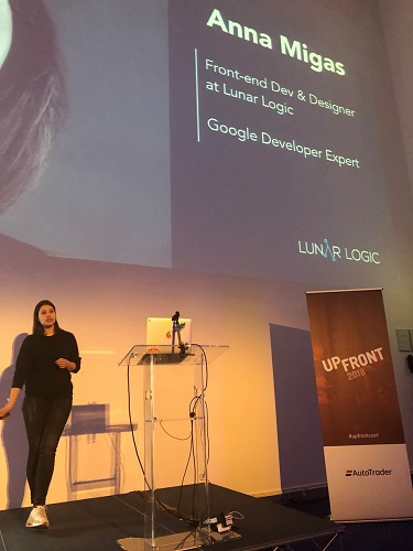 A photo of Anna presenting on stage