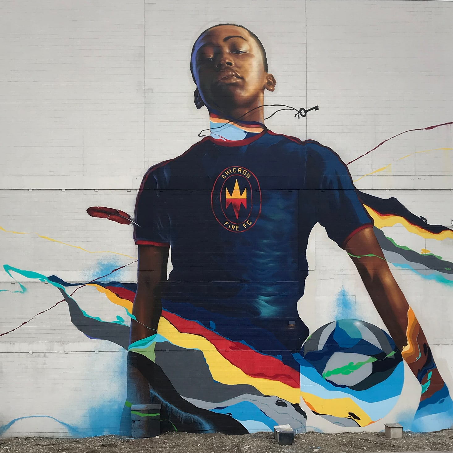 painted mural of young athlete