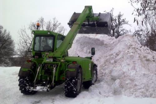 telehandler shoveling snow