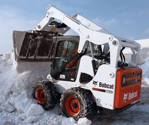 skid steer shoveling snow