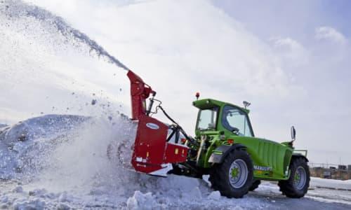 Telehandlers shoveling snow