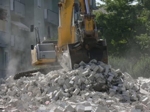 Excavator digging bricks