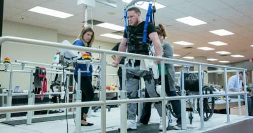 Medical exoskeletons helping a man walk