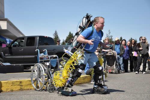 Monty Reed walking with exoskeleton life suit